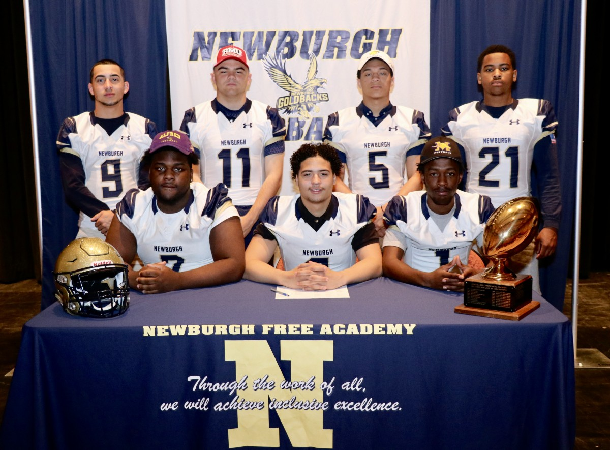 Eight students who signed to play football in college.