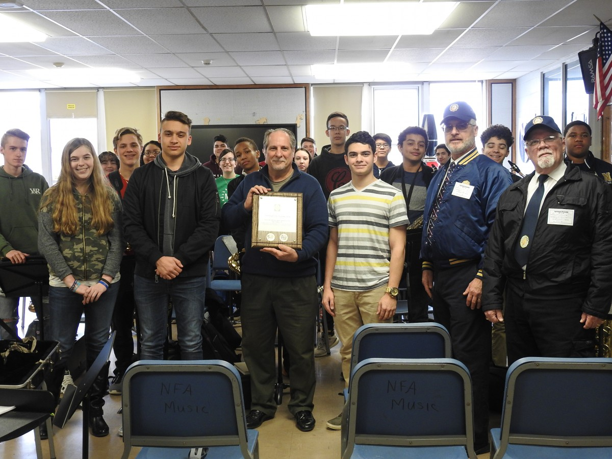 Mr. Zoutis pictured with the NFA Band and their plaque.