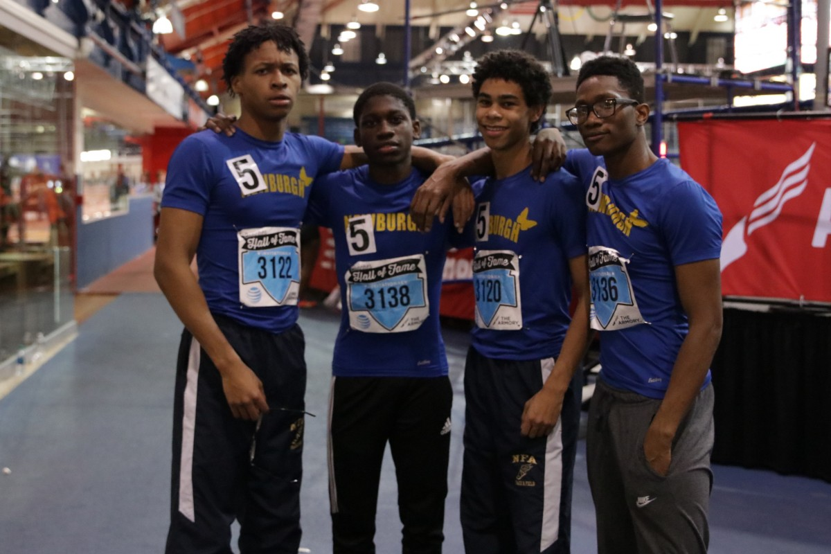 Members of the Boys Track team pose for a photo
