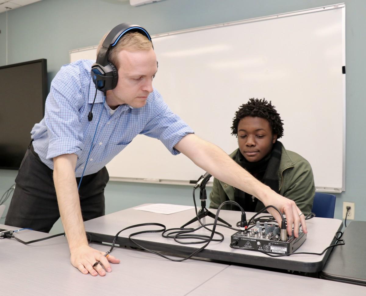 Dr. Gallagher adjusting the sound board