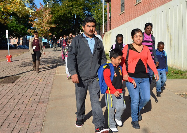 Students and families marching 2