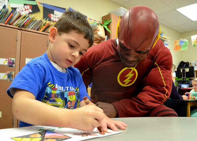The Flash watching a student color