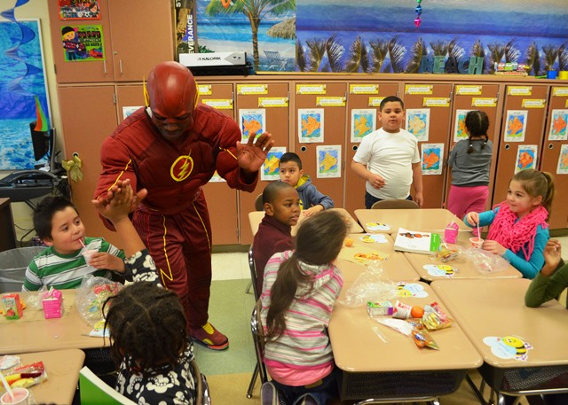 The Flash greeting students in the classroom