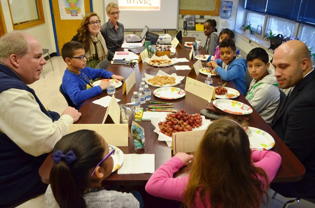Students eat lunch and discuss their thoughts with the Superintendent
