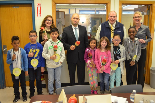 Group photo of students and the superintendent