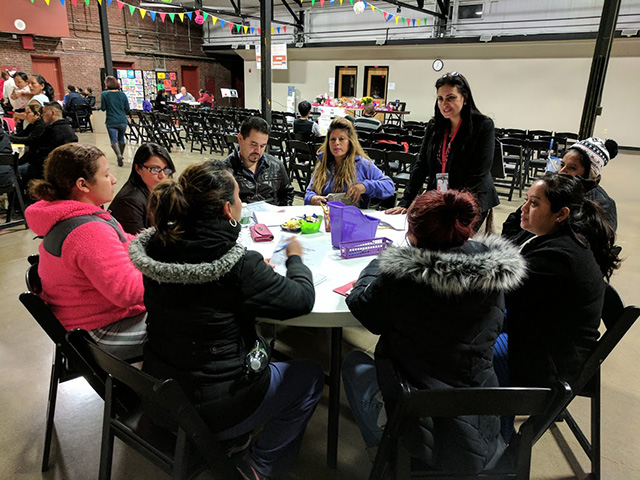 Parent work in small groups on projects