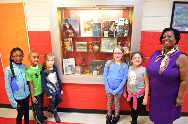 Students and Asst. Principal Johnson infront of BHM display case.