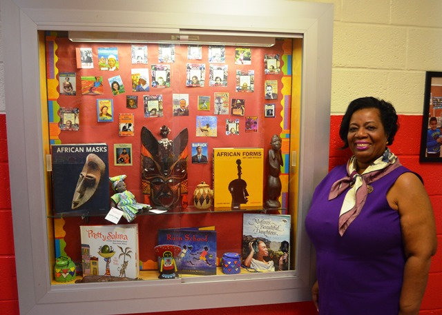 Beverley Johnson in front of display case.
