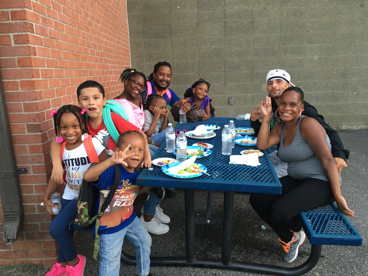 Parents and students at the picnic tables.
