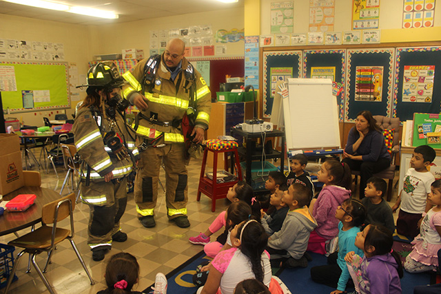 Another photo of firefighters in the classroom