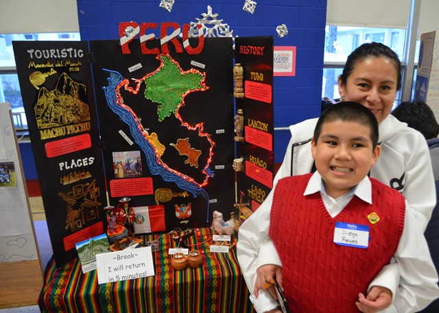 A parent and student with their Peru project.