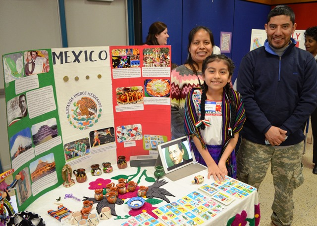 A student and family with their Mexico project
