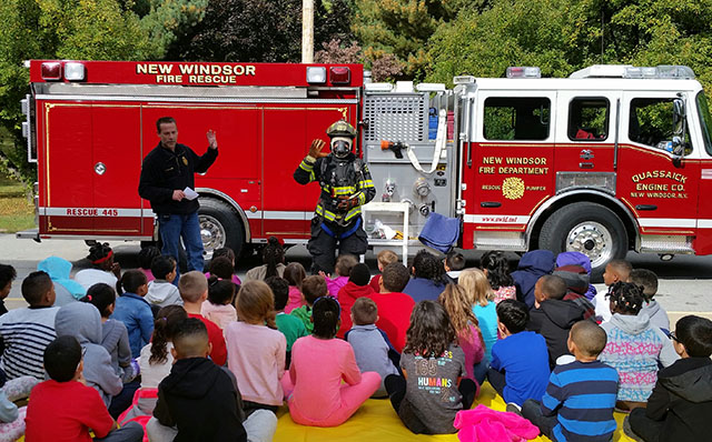 Firefighters talking to students