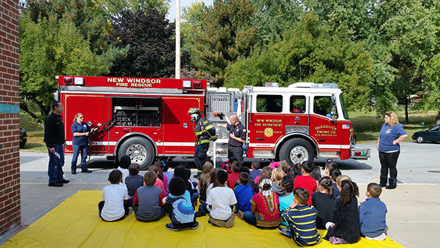 Students infront of a fire engine