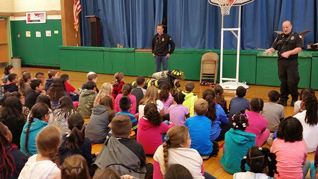 Inside the school at the fire safety assembly