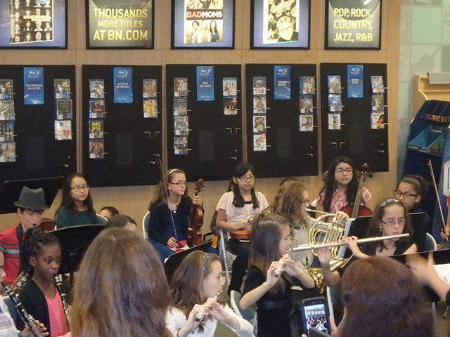 Student performing with their musical instruments