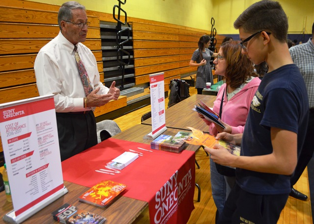 Students in the College and Career Fair talking to representatives 2