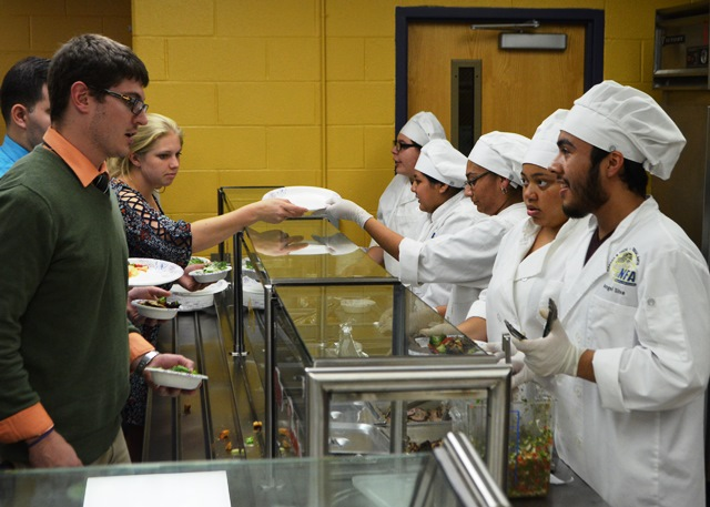 Students serving the reps dinner.