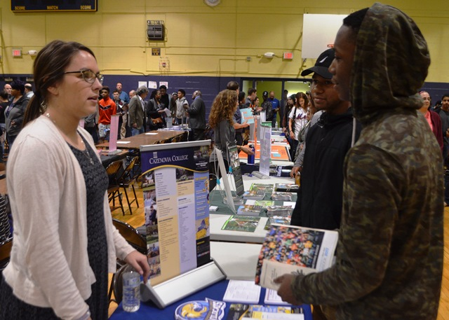 Students in the College and Career Fair talking to representatives 5