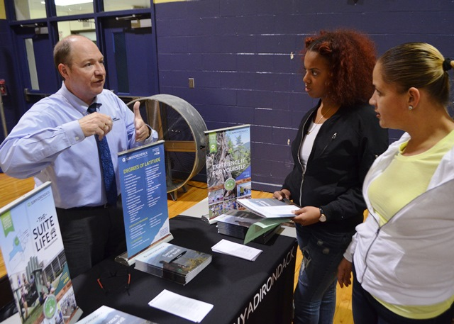 Students in the College and Career Fair talking to representatives 6