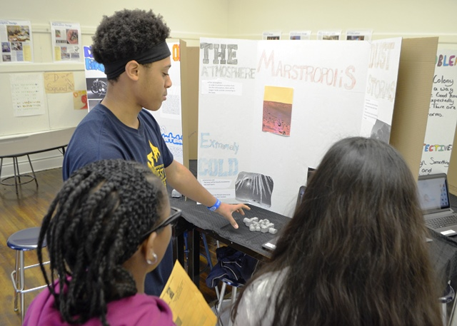 A student showcasing his work