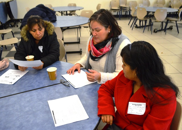 In small groups, parents discuss issue with the administrators
