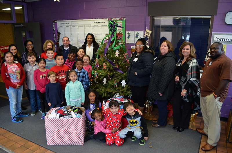 Vails Gate Students and Faculty stand next to sock donation