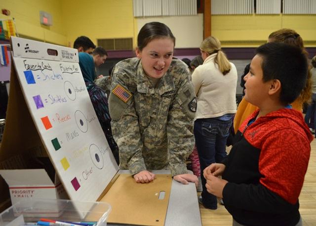 A cadet helps a student understand a problem.
